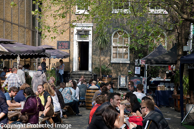People Eating and Drinking in the Beer Garden in the Vibe Bar, Brick Lane, London
