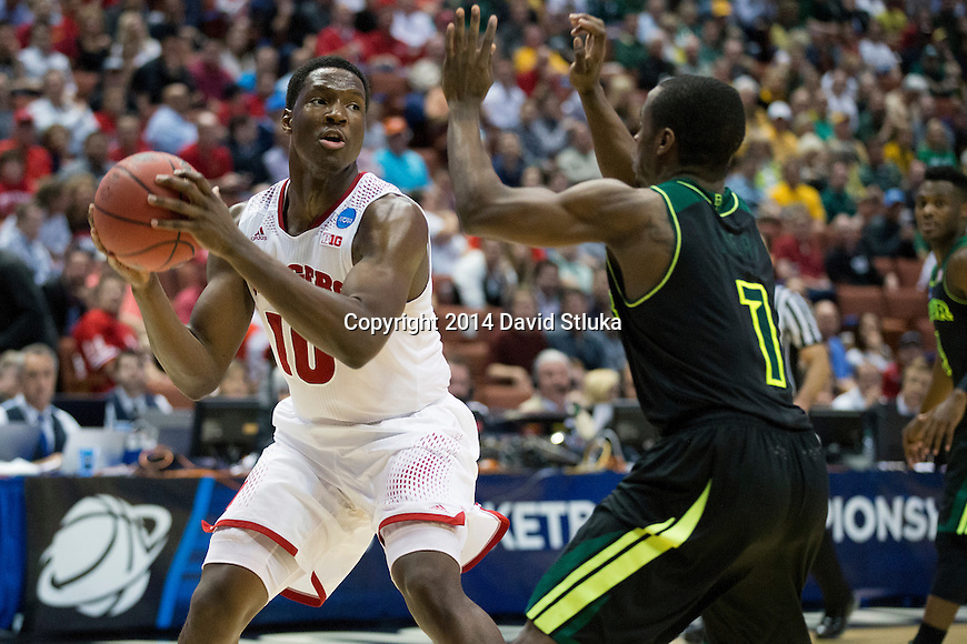 Wisconsin Badgers forward Nigel Hayes (10) handles the ball during a regional semifinal NCAA college basketball tournament game against the Baylor Bears Thursday, March 27, 2014 in Anaheim, California. The Badgers won 69-52. (Photo by David Stluka)