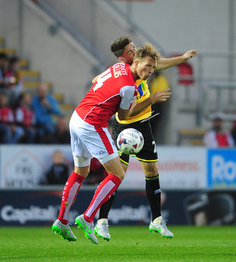 Norwich City's Ricky van Wolfswinkel vies for possession with Rotherham United's Danny Collins<br /> <br /> Photographer Chris Vaughan/CameraSport<br /> <br /> Football - Capital One Cup Second Round - Rotherham United v Norwich - Tuesday 25th August 2015 - New York Stadium - Rotherham<br />  <br /> &copy; CameraSport - 43 Linden Ave. Countesthorpe. Leicester. England. LE8 5PG - Tel: +44 (0) 116 277 4147 - admin@camerasport.com - www.camerasport.com