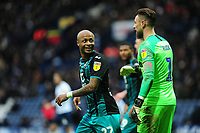 Andre Ayew of Swansea City exchanges words with Declan Rudd of Preston North End during the Sky Bet Championship match between Preston North End and Swansea City at the Deepdale Stadium in Preston, England, UK. Saturday 01 February 2020