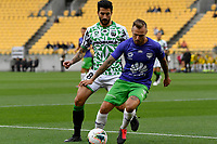David Ball of Wellington Phoenix struggles to keep the ball from Panagiotis Kone of Western United FC during the A League - Wellington Phoenix v Western United FC at Sky Stadium, Wellington, New Zealand on Friday 21 February 2020. <br /> Photo by Masanori Udagawa. <br /> www.photowellington.photoshelter.com