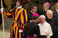 Papa Francesco saluta un vescovo al termine dell'udienza generale del mercoledi' in aula Paolo VI, Citta' del Vaticano, 13 gennaio 2016.<br /> Pope Francis greets a bishop at the end of his weekly general audience in the Paul VI hall at the Vatican, 13 January 2016.<br /> UPDATE IMAGES PRESS/Riccardo De Luca<br /> <br /> STRICTLY ONLY FOR EDITORIAL USE