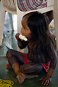 """Altamira, Brazil. """"Xingu Vivo Para Sempre"""" protest meeting about the proposed Belo Monte hydroeletric dam and other dams on the Xingu river and its tributaries. Menire Kayapo eating an iced lolly."""