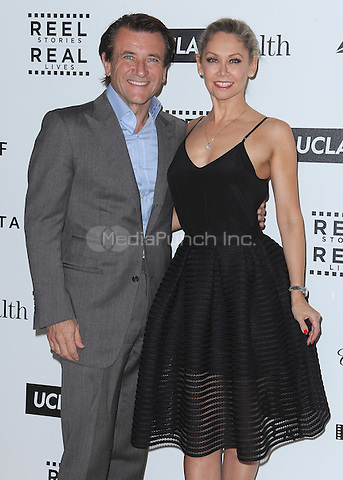 LOS ANGELES, CA - APRIL 25:  Kym Johnson and Robert Herjavec at the 4th Annual Reel Stories, Real Lives Benefit at Milk Studios on April 25, 2015 in Los Angeles, California. Credit: mpiPGSK/MediaPunch