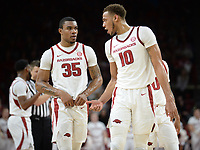 NWA Democrat-Gazette/ANDY SHUPE<br /> Arkansas forward Daniel Gafford (10) speaks with forward Reggie Chaney against LSU Friday, Jan. 11, 2019, during the first half of play in Bud Walton Arena in Fayetteville. Visit nwadg.com/photos to see more photographs from the game.
