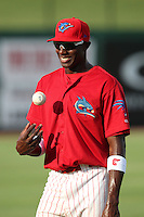 Clearwater Threshers Jiwan James #23 warms up before a game against the Daytona Cubs at Brighthouse Stadium on June 23, 2011 in Clearwater, Florida.  Clearwater defeated Daytona 6-5.  (Mike Janes/Four Seam Images)