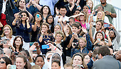 Crowd waves to His Holiness Pope Francis on his arrival at Joint Base Andrews in Maryland on September 22, 2015. The Pope is making his first trip to the United States on a three-city, five-day tour that will include Washington, D.C., New York City and Philadelphia.<br /> Credit: Olivier Douliery / Pool via CNP