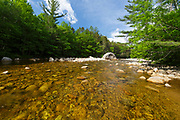 The East Branch of the Pemigewasset River in the Pemigewasset Wilderness of Lincoln, New Hampshire USA during the spring months. At 45,000 acres, the Pemigewasset Wilderness is the largest designated wilderness in New Hampshire. And this area was logged during the East Branch & Lincoln Railroad era (1893 -1948).