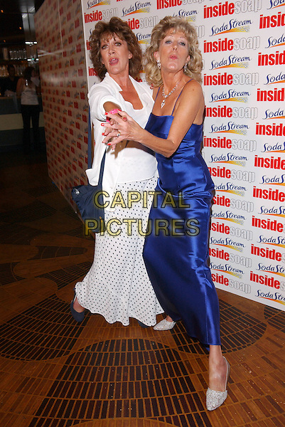 AMANDA BARRIE & SUE NICHOLS.The Inside Soap Awards, La Rascasse, Cafe Grand Prix.Monday, September 27th, 2004.full length, blue dress, silk, satin, polka dot skirt, dancing, gesture, funny.www.capitalpictures.com.sales@capitalpictures.com.© Capital Pictures.