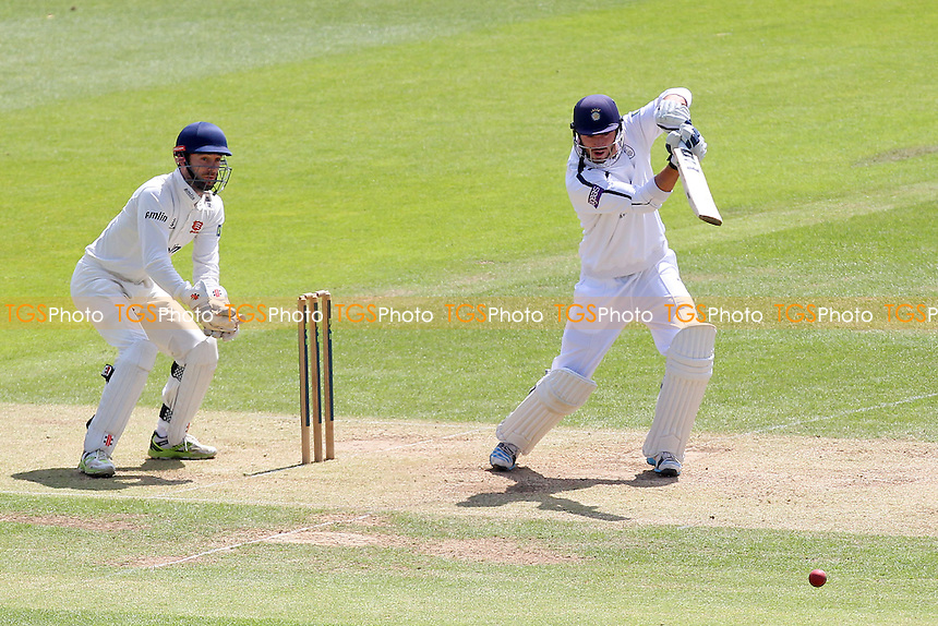 Essex wicket keeper James Foster can only watch as James Vince of Hampshire drives the ball to the boundary to reach 1,000 runs in the County Championship this season - Hampshire CCC vs Essex CCC - LV County Championship Division Two Cricket at the Ageas Bowl, West End, Southampton - 17/06/14 - MANDATORY CREDIT: Gavin Ellis/TGSPHOTO - Self billing applies where appropriate - 0845 094 6026 - contact@tgsphoto.co.uk - NO UNPAID USE