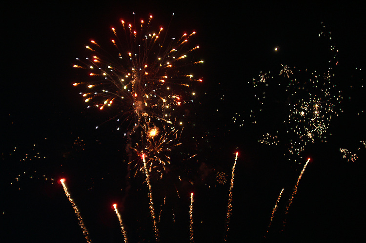 Fireworks light up the night sky.