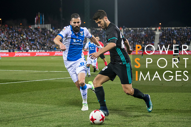 Marco Asensio Willemsen (R) of Real Madrid fights for the ball with Dimitrios Siovas of CD Leganes during the Copa del Rey 2017-18 match between CD Leganes and Real Madrid at Estadio Municipal Butarque on 18 January 2018 in Leganes, Spain. Photo by Diego Gonzalez / Power Sport Images