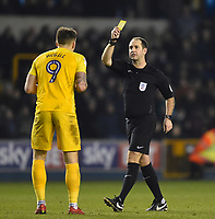 Referee Jeremy Simpson shows Preston's Jordan Hugill a yellow card <br /> <br /> Photographer Jon Hobley/CameraSport<br /> <br /> The EFL Sky Bet Championship - Millwall v Preston North End - Saturday 13th January 2018 - The Den - London<br /> <br /> World Copyright &copy; 2018 CameraSport. All rights reserved. 43 Linden Ave. Countesthorpe. Leicester. England. LE8 5PG - Tel: +44 (0) 116 277 4147 - admin@camerasport.com - www.camerasport.com