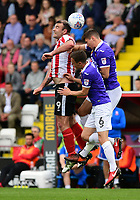 Lincoln City's Matt Rhead vies for possession with Exeter City's Jordan Tillson, centre, and Exeter City's Jordan Storey<br /> <br /> Photographer Chris Vaughan/CameraSport<br /> <br /> The EFL Sky Bet League Two Play Off First Leg - Lincoln City v Exeter City - Saturday 12th May 2018 - Sincil Bank - Lincoln<br /> <br /> World Copyright &copy; 2018 CameraSport. All rights reserved. 43 Linden Ave. Countesthorpe. Leicester. England. LE8 5PG - Tel: +44 (0) 116 277 4147 - admin@camerasport.com - www.camerasport.com