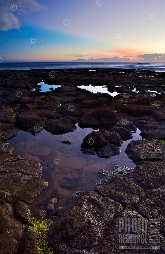 Purple rays shine over the horizon from Poipu, Kauai.