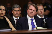 WASHINGTON, DC - SEPTEMBER 27:  White House Counsel Don McGahn (C) listens to Judge Brett Kavanaugh as he testifies before the Senate Judiciary Committee during his Supreme Court confirmation hearing in the Dirksen Senate Office Building on Capitol Hill September 27, 2018 in Washington, DC. Kavanaugh was called back to testify about claims by Christine Blasey Ford, who has accused him of sexually assaulting her during a party in 1982 when they were high school students in suburban Maryland.  (Photo by Win McNamee/Getty Images)