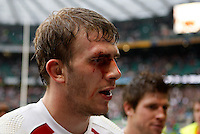 Photo: Richard Lane/Richard Lane Photography. .England v Ireland. RBS Six Nations. 15/03/2008. England's Tom Croft leaves the field at the end of the match, with blood on his face.
