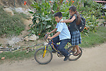 Eleven-year old Juan Lopez and his 9-year old sister Yarelly ride a bike to school in Zipolite, a town in Oaxaca, Mexico. Juan is blind, and yet rides his bike with his sister's help. She perches on the back and signals him which way to steer by pinching his shoulder. If she pinches his right shoulder, for example, he goes right. The harder the pinch, the sharper the turn.
