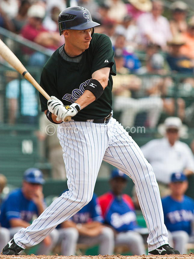 Mar 20, 2009; Tucson, AZ, USA; Colorado Rockies second baseman Clint Barmes swings at a pitch in the bottom of the 2nd inning of a spring training game against the Texas Rangers at Hi Corbett Field.  The Rangers defeated the Rockies 11-5.