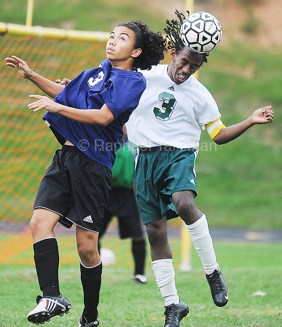 The Gazette Parkdale High School's captain Awet Gebremedhin, right gets a head on the ball as he fends off Northwestern High School's Moises Rivera during the first-half of Parkdale's 2-0 victory at Parkdale High School on Tuesday afternoon.
