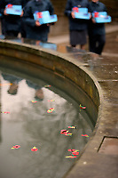 Pictured: Young cadets walk past the poppies placed in the fountain. Saturday 11 November 2017<br />Re: Armistice Day, two minutes were observed to mark remembrance at Castle Square in Swansea, Wales, UK.