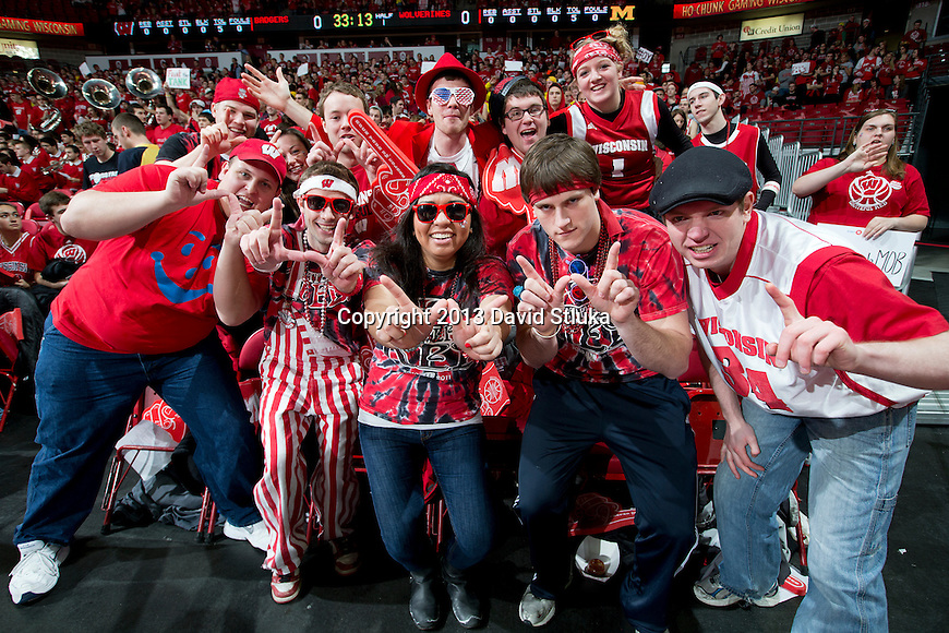 Wisconsin Badger fans pose for a photo during a Big Ten Conference NCAA college basketball game against the Michigan Wolverines Saturday, February 9, 2013, in Madison, Wis. The Badgers won 65-62 (OT) (Photo by David Stluka)