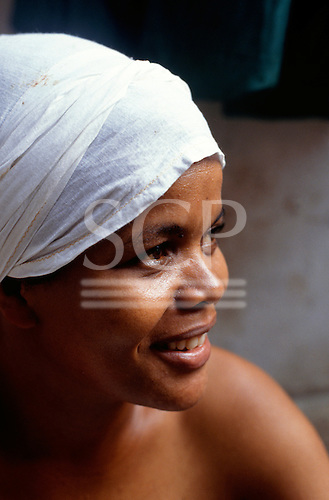 Recife, Brazil. Young follower of Candomble at the Friday night ceremony at the Terreiro (sacred gathering place).