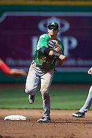 Dayton Dragons shortstop Juan Perez #11 throws to first in a pickoff attempt during a Midwest League game against the Fort Wayne TinCaps at Parkview Field on August 19, 2012 in Fort Wayne, Indiana.  Dayton defeated Fort Wayne 5-1.  (Mike Janes/Four Seam Images)