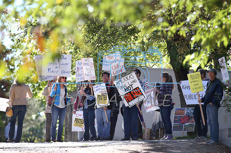 A small group of protesters rally as Republican presidential hopeful Jeb Bush talks with ranchers and elected officials at Rancho San Rafael Park in Reno, Nev., on Wednesday, Oct. 21, 2015. Bush announced his western lands priorities during the event. (Cathleen Allison/Las Vegas Review-Journal)