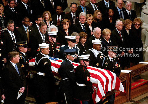 The casket containing the remains of former United States President Gerald R. Ford is carried by a military honor guard into the Washington National Cathedral, in Washington, D.C. on Tuesday, January 2, 2007. In the front row are: President George W. Bush,first lady Laura Bush,Vice President Dick Cheney, Lynne Cheney,former President Jimmy Carter, former first lady Roslyn Carter, and former first lady Nancy Reagan.  In the second row are former President George H.W. Bush, former first lady Barbara Bush, Doro Bush Koch, former President Bill Clinton, former first lady Senator Hillary Rodham Clinton (Democrat of New York), Chelsea Clinton, Secretary of State Condoleezza Rice, Secretary of the Treasury Henry M. Paulson, Jr., and Secretary of Defense William Gates.  Jack Ford looks on from far left..Credit: Ron Sachs / CNP.[NOTE: No New York Metro or other Newspapers within a 75 mile radius of New York City].