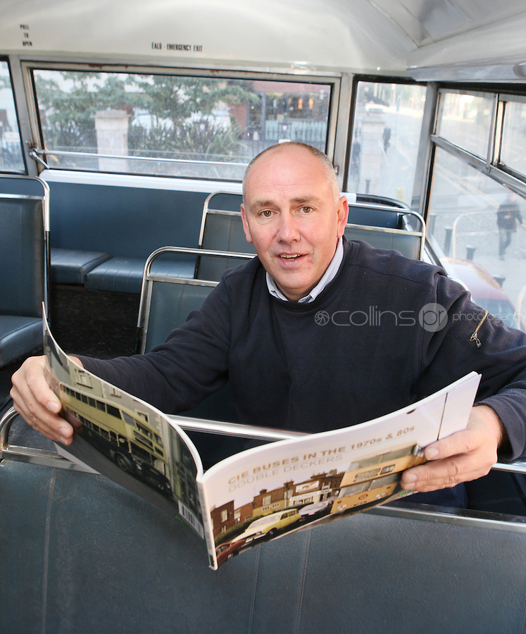 """NO FEE. 20/10/2010. Vintage CIE Double Decker Bus Makes One Last Stop . Dublin based bus enthusiast Ed O'Neil is pictured to mark the launch oftwo new books on CIE Buses in the 1970's and 1980's, avintage CIE double decker bus, outside the Mansion House on Dawson Street, Dublin.he coffee table books have been published by PRC Publications, a new transport publications company based in Dublin, and feature a miscellany of photographs of Irish buses and street scenes in both rural and urban locations, taken by Ed O'Neill from mid 1970 to mid 1980. A self-confessed """"bus nut"""", O'Neill has compiled the two books which will appeal to both enthusiasts and the general public alike. Urban street scenes, including traffic on Dublin's Grafton Street, will remind readers of a time long gone when traffic regulations were far more relaxed and beautiful buildings stood tall, many of which are sadly no longer in existence. The books, 'CIE Buses in the 1970s and 80s - Double Deckers' and 'CIE Buses in the 1970s and 80s - Single Deckers'are priced at EUR25.00 per book (or both books for EUR45.00) and are available from Mark's Models branches or online atwww.prcpublications.com. Picture James Horan/Collins Photos"""