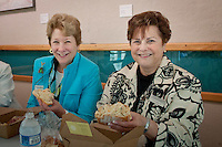 Judy Hushon and Joan Kessler enjoy a boxed lunch at a preview exhibition of  'Cuba on My Mind' featuring works of 11 Cuban artists, at The von Liebig Art Center, Naples, Florida, USA, March 10, 2011. Photo by Debi Pittman Wilkey