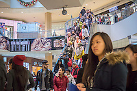 Crowds of last minute shoppers pack the Queens Center mall in the borough of Queens in New York on Super Saturday, December 20, 2014 looking for bargains for their Christmas gifts. Super Saturday, the Saturday prior to Christmas was crowded with shoppers and is expected to generate more sales than Black Friday.  (© Richard B. Levine)