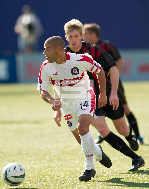 Chris Armas of the Fire is chased by John Wolyniec of the MetroStars. The Chicago Fire defeated the NY/NJ MetroStars 2-1 on 8/24/03 at Giant's Stadium, NJ..
