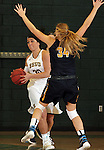 SPEARFISH, SD - JANUARY 8, 2016 -- Kassidy Scott #30 of Black Hills State looks past Regis defender Karlyn Johnson #34 during their college basketball game Friday at the Donald E. Young Center in Spearfish, S.D. (Photo by Dick Carlson/Inertia)