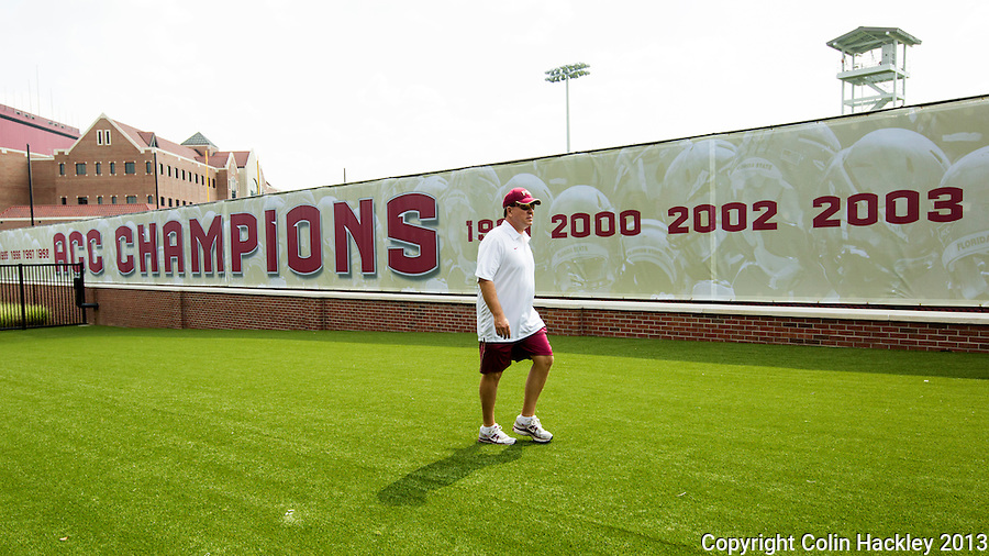 TALLAHASSEE, FLA.8/6/13-FSU080613CH-Florida State's Head Coach Jimbo Fisher walks out to the Seminole's first day of practice Aug. 6, 2013 in Tallahassee, Fla.<br /> <br /> COLIN HACKLEY PHOTO