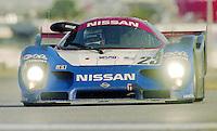 The #23 Nissan R91 CP of Masahiro Hasemi, Kazuyoshi Hoshino, Toshio Suzuki, and Anders Olofsson races to victory in  the 24 Hours of Daytona, Daytona International Speedway, Daytona Beach, FL, February 2, 1992.  (Photo by Brian Cleary/www.bcpix.com)