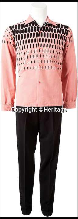 BNPS.co.uk (01202 558833)<br /> Pic: Heritage/BNPS<br /> <br /> ***Please Use Full Byline***<br /> <br /> The front view of Elvis' suit and corduroy shirt.<br /> <br /> The outfit Elvis Presley was wearing when he signed the momentous recording contract that rocketed him to international stardom has emerged for sale for 24,000 pounds.<br /> <br /> Despite being just 20 when he put pen to paper, Elvis was already the hottest thing in country music and was snapped up by record label giant RCA for a whopping 40,000 dollars - the equivalent of almost 400,000 dollars or 237,000 pounds today.