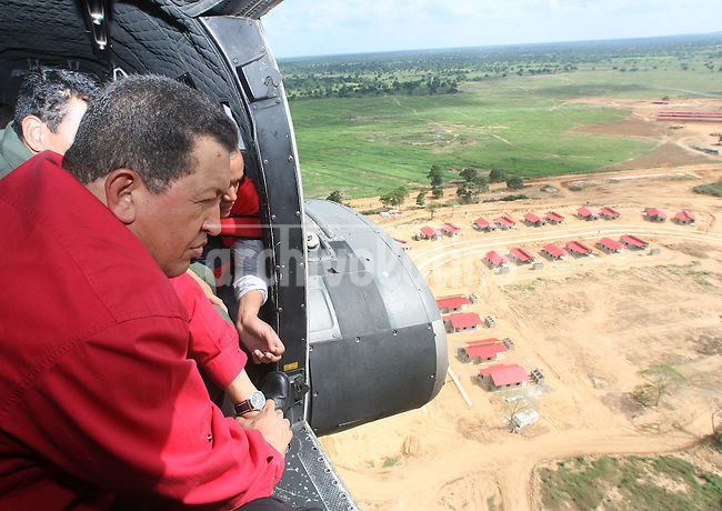 President of Venezuela Hugo Chavez observes from an helicopter a housing project for the poor inaugurated few days before the referendum on the constitutional reform that will allow him to run for president undefinetely.