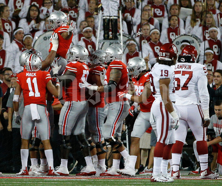 Players raise up Ohio State Buckeyes running back J.K. Dobbins (2) after he scored a touchdown during the third quarter of a NCAA college football game between the Ohio State Buckeyes and the Oklahoma Sooners on Saturday, September 9, 2017 at Ohio Stadium in Columbus, Ohio. [Joshua A. Bickel/Dispatch]