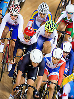 06 AUG 2012 - LONDON, GBR - Laura Trott (GBR) (centre row left with red helmet) of Great Britain rides in the pack during the Women's Omnium 20km Points Race at the London 2012 Olympic Games track cycling at the Olympic Park Velodrome in Stratford, London, Great Britain (PHOTO (C) 2012 NIGEL FARROW)
