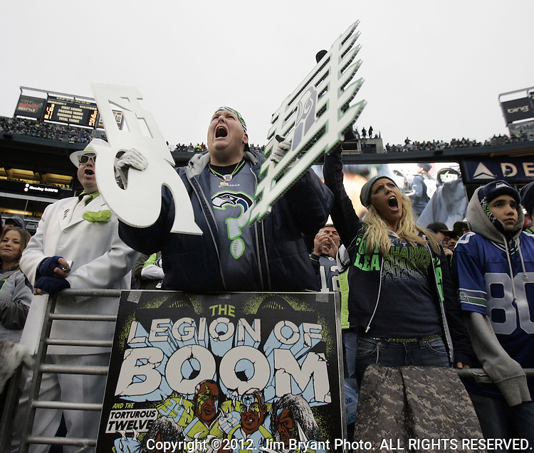 "Seattle Seahawks fan Lorin ""Big Lo"" Sandretzky, center,  cheers against the Arizona Cardinals at CenturyLink Field in Seattle, Washington on  December 9, 2012.  The Seahawks beat the Cardinals 58-0.  ©2012. Jim Bryant Photo. All Rights Reserved."