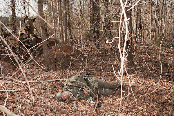 February 18, 2012. Enfield, NC.. A soldier of the 208 Infantry Regiment lays dead after being shot attacking an American gun position..  Reenactors depict German infantry units in a reenactment of the Battle of the Rhineland, which took place September 15, 1944- March 21, 1945..
