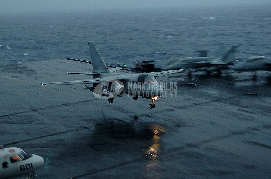 "041014-N-6213R-024 Western Pacific Ocean (Oct. 14, 2004) - An S-3B Viking from the ""Redtails"" of Sea Control Squadron Two One (VS-21) prepares to land on the wet flight deck aboard USS John C. Stennis (CVN 74) during an evening rainshower.  Stennis and embarked Carrier Air Wing Fourteen (CVW-14) are at sea on a scheduled deployment to the Western Pacific Ocean. Photo by Mark J. Rebilas"