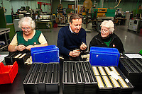 Wednesday 19 February 2014<br /> Pictured:Factory workers Audrey John and Ann Griffiths with Prime Minister David Cameron ( Centre )<br /> Re: Prime Minister David Cameron visitingthe  St David Assemblies factory  in St. Davids, Pembrokeshire, Wales