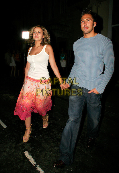 """CHARLOTTE CHURCH & GAVIN HENSON.Leaving """"5 Cavendish Square"""" club in the early hours, .London..July 16th, 2005.celebrity couple boyfriend girlfriend white tank top pink skirt holding hands blue sweater full length.www.capitalpictures.com.sales@capitalpictures.com.©Capital Pictures."""