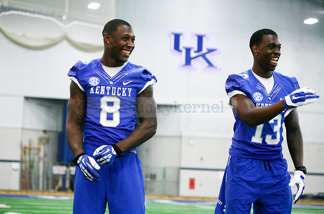 Wide receivers Javess Blue and Jeff Badet laugh in between photos during UK football media day at Nutter Field House in Lexington, Ky., on Friday, August 8, 2014. Photo by Adam Pennavaria | Staff