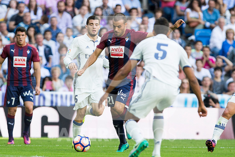 Real Madrid's Mateo Kovacic  Eibar's Pedro Leon and Real Madrid's Raphael Varane durign the match of La Liga between Real Madrid and SD Eibar at Santiago Bernabeu Stadium in Madrid. October 02, 2016. (ALTERPHOTOS/Rodrigo Jimenez)