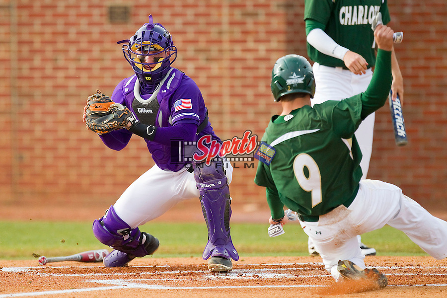 Brad Elwood (9) of the Charlotte 49ers slides into home plate as catcher Spencer Angelis (11) of the High Point Panthers waits to apply the tag at Willard Stadium on February 20, 2013 in High Point, North Carolina.  The 49ers defeated the Panthers 12-3.  (Brian Westerholt/Sports On Film)