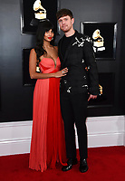 Jameela Jamil, left, and James Blake arrive at the 61st annual Grammy Awards at the Staples Center on Sunday, Feb. 10, 2019, in Los Angeles. (Photo by Jordan Strauss/Invision/AP)